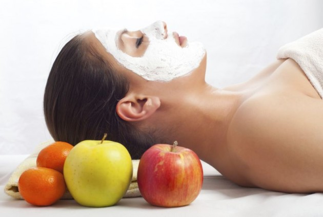 Beautiful woman with natural facial mask on face